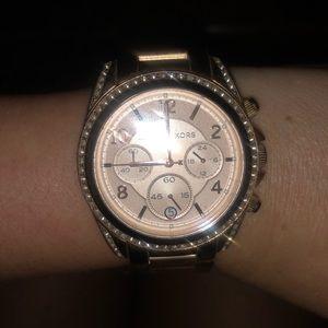 Michael Kors rose gold women's wrist watch.